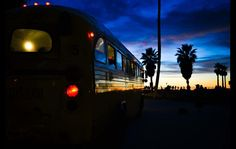 An old bus in Venice reflects the colors of the sky at sunset in this image by Betto Rodrigues