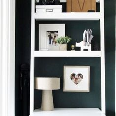 Storage ideas from Crate and Barrel! A white ladder shelf is such a great piece of furniture to have!