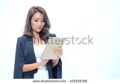 Portrait beautiful asian woman standing, Hold tablet On the white background