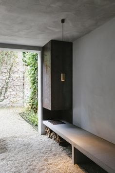 Outdoor wood-burning fireplace with concrete bench. Project Renovation House V in Antwerp, Belgium, designed by Hans Verstuyft Architecten. Photographed by The Fresh Light. Contemporary Architecture, Interior Architecture, Interior And Exterior, Interior Design, Outdoor Wood Burning Fireplace, Kitchen Wall Design, Magazine Deco, Concrete Bench, Minimal Home