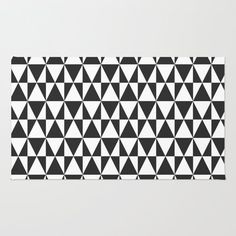 Society6 - Black White Geometric Hipster Triangles Pattern Rug by Girly Road Society6  / $28 / Size: 2'x3' / amazon.com