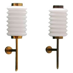 Rare pair of 1950's brass Arredoluce wall lamps by Angelo Lelli   From a unique collection of antique and modern wall lights and sconces at https://www.1stdibs.com/furniture/lighting/sconces-wall-lights/