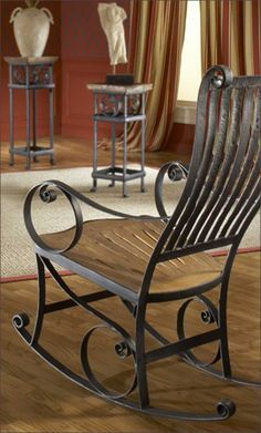 Made from reclaimed teak wood and salvaged iron, this western style rocking chair is great for the patio or inside the home. Due to the unique crafting, this item may vary in shape and color.