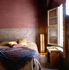 dusty rose walls, stone coloring (tile?) on lower part...I love that it allows for the purple and pink bed spread.  Those types of windows don't really exist anymore though.  Alternatives?  Maybe a jewelry rack in an old frame?