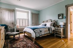 The bed in the master bedroom is from Anthropologie.