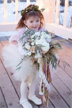 Winter flower girl ideas. Captured By: Romancing Belle Photography http://www.weddingchicks.com/2014/05/26/glamorous-vow-renewal-ceremony/