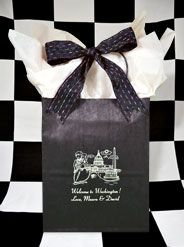 """This black kraft #weddingwelcomebag is printed in white ink. The cartoon design, #WashingtonDCWedding Couple is a fun & whimsical idea for any couple getting married in our nation's capitol. This sturdy bag measures 8x10x5"""" deep excluding the handle which adds another 5"""". Welcome your guests with 2 bottles of water, 2 pieces of fresh fruit, and sightseeing brochures available from your local Visitors Center. www.FavorsYouKeep.com  -Austin, TX #personalizedweddingwelcomebag…"""