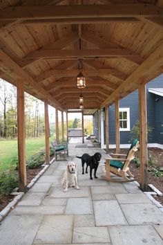 Covered walkway between detached garage/guesthouse and main structure. Love the lofted ceilings and lighting. contemporary patio by Birdseye Design