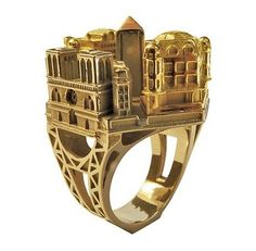 Architecture jewelry by Philippe Tournaire. The new Paris ring has a perfect little replica of the Notre Dame Cathedral's Facade. Shown cast in rose and yellow and all yellow gold.