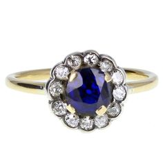 1920s Sapphire Diamond Gold Daisy Cluster Ring | From a unique collection of vintage cluster rings at https://www.1stdibs.com/jewelry/rings/cluster-rings/