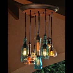 This is an 8 pendant reycled bottle chandelier made from recycled bottles. The rubber cords are mounted to a 24 birch plywood canopy with metal