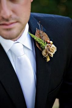 Rich browns complimented by nature's greens make this boutonnier perfect for an outdoor wedding.