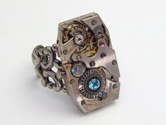 Steampunk Ring with adjustable filigree band and watch movement gears and aquamarine blue crystal  #SteampunkRing #SteampunkJewelry #SteampunkJewelrybyMariaSparks