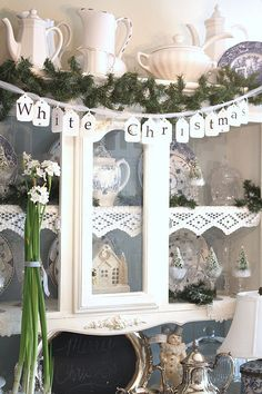 I pinned this not only for the cute white Christmas banner, but also because of the idea of the lace edging on the shelves.  How pretty!