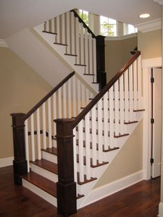 Wood treads, white and wood banister More