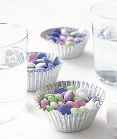 Fill sturdy foil cupcake holders with mixed nuts, mints, hard candy, or candy corn and scatter them around a party. Or, to make kids swoon at a birthday, place an individual cupcake holder at each setting.