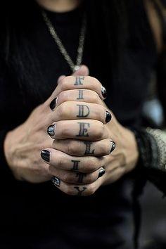 Ashley Purdy's finger tattoos