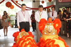 Principal of Singapore Polytechnic, Mr Tan Choon Sian and President of Singapore Poly Graduates' Guild, Mr Jimmy Lim receiving the blessings from SP lion dance troupe