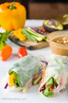 Eat your greens, and your reds, and your yellows, and more with these easy, convenient, and tasty Rainbow Veggie Spring Rolls with Ginger Peanut Sauce