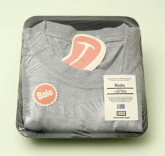 Mooks Meat clingwrap t-shirt packaging. If you want to customize your own t-shirt packaging, visit www.unifiedmanufacturing.com