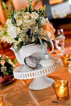 This is so charming -- White porcelain teapot and cake stand topped with cream florals