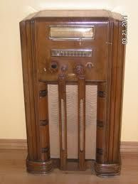 Floor Model vintage radio 1930-40s. My grandparents had a matching radio bench that sat in front of it for tuning or listening.My parent's radio had a drawer with a record player in it.