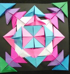First off, I found this very creative to make a design with a bunch of sticky notes, so it's very original. Second, I also saw the symmetry in this picture and the radial balance in it; how everything connects in the center.