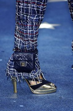 Chanel. Of course! Who else could have invented the chic alternative to the fanny pack!? Strap a gorgeous purse to your ankle. Brilliant. :)