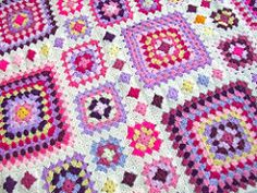 A shabby chic granny square throw perfect for your favourite cosy chair or picnics!