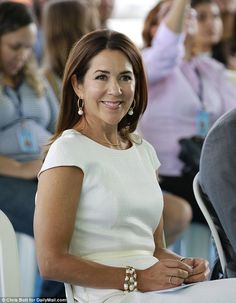 All white: The 44-year-old wore a fitted white dress with pearl earrings and a matching br...