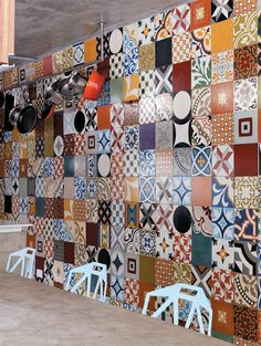 Andrade uses a wall of colored concrete (hydraulic) tiles to bring color into his kitchen.