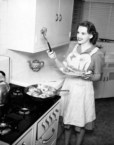 Judy Garland frying chicken. I love the kitchen. Nobody understands me, but I love an old kitchen....