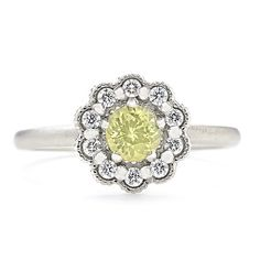 Featuring a gorgeous mosaic design crafted in white gold with diamond details, this artistically crafted ring centers around a one-of-a-kind, natural yellow sapphire gem.  at Greenwich Jewelers, $1920