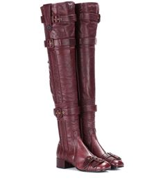 Prada - Leather over-the-knee boots - First seen at Milan Fashion Week, Prada's over-the-knee boots will make a sophisticated and modern addition to your fall and winter footwear edit. Made in Italy, the style features a rich burgundy leather upper with multiple buckle straps and seam details that emphasise the silhouette. Emulate the runway look and style yours with a black midi dress. seen @ www.mytheresa.com