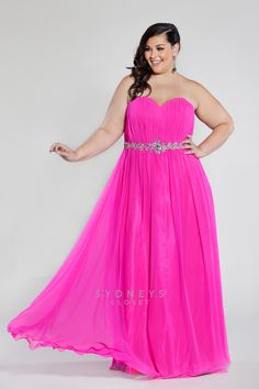 Stand out in the crowd at #prom with this electric pink gown. Available in sizes 14 to 32 this #plussize frock has a jeweled waist, optional straps and a matching chiffon shawl included.