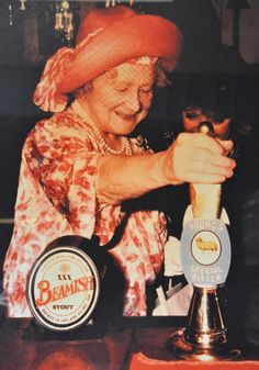 The Queen Mother's picture was taken in 1981, while celebrating the 40th anniversary of the Battle of Britain. Finding herself a little parched she nipped into an east end pub for a quick pint of Special. You will notice that she pours the pint with her handbag securely looped through her arm, sound advice to keep one's handbag close at all times when drinking in the East End.
