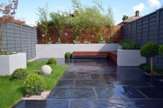 Modern Garden Design London Contact anewgarden for more information Garden Design London, Back Garden Design, London Garden, Grey Fence Paint, Fence Paint Colours, Design Cour, Small Yard Design, Slate Garden, Cedar Garden