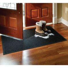 Must get this, with winter fast approaching :(  The 12 Pint Absorbing Low Profile Door Mat - Hammacher Schlemmer