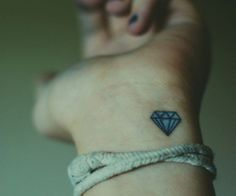 This might be the one!!   Small diamond tattoo