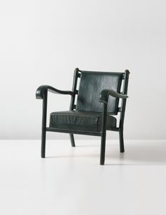 Jacques Adnet; Leather-Covered Metal and Brass Armchair, 1950s.
