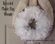 Recycled plastic bag wreath. Plain white looks kind of christmas-y, but maybe stock up on colored bags to make something more spring-y?