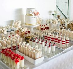 Dessert bar with wedding cake in the middle-- love the understated gold and pink!