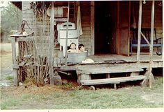 Saturday night bath... and the wringer washer on the front porch.  I remember the good ole' days!!