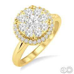 Yellow gold, diamond cluster engagement ring with diamond halo.