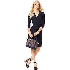 Tommy Hilfiger women's dress. So simple yet so chic, the ever-flattering wrap dress styled in soft, figure-skimming fabric. At once easy and elegant, this is the timeless classic you'll be reaching for all year long.<br>•Classic fit, approximately 37'' from shoulder to hem.<br>•92% viscose, 8% elastane.<br>•¾ length sleeves, shirred waist and bodice.<br>•Machine washable. <br>•Imported.<br>