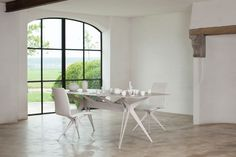 All white table with ceramics tabletop. Taille Poker by Mathias De Ferm for Sitino.
