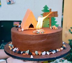 A camp-themed birthday party wouldn't be complete without a real-life campfire on the cake.