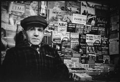 Subway newsstand vendor in front of magazine display, New York City, (Photo credit: Walker Evans / Metropolitan Museum of Art) Walker Evans Photography, Sabine Weiss, Michael Wolf, The Beatles 1, Jeanloup Sieff, Ralph Gibson, Willy Ronis, Honore Daumier, Berenice Abbott