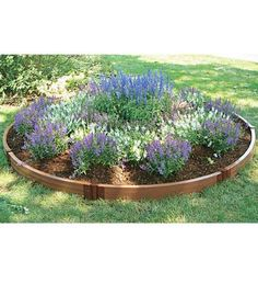 I like round flower beds.  It is good feng shui with no corners to cut  chi.