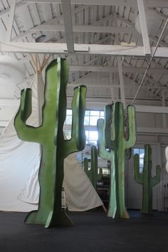 life sized cardboard cacti  inside the studio of hollis hart.